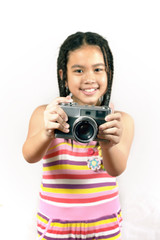 Portrait of the little girl with vintage camera isolated