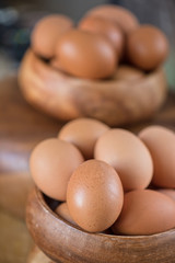 Fresh eggs at wooden plate