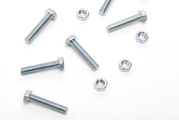 Bolts and nuts and washers on white paper