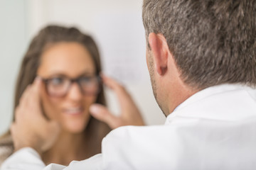 Woman choosing her new glasses