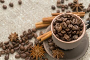 Coffee beans, cinnamon, star anise on sackcloth.