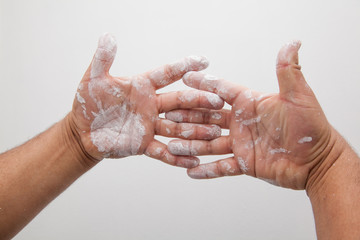 Hands with white color paint stains