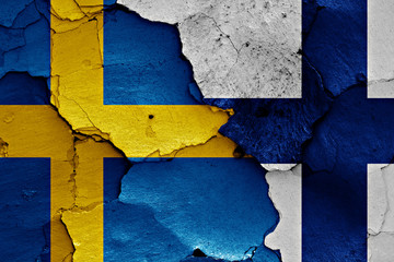 flags of Sweden and Finland painted on cracked wall