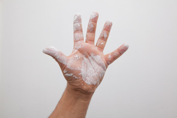 hand with white paint color stains