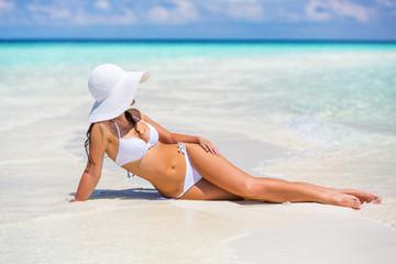 Young woman in bikini relaxing on the beach