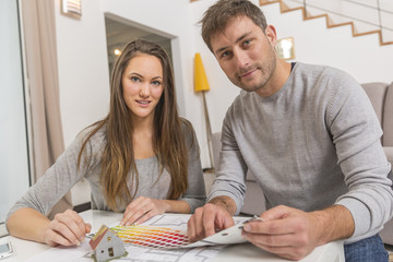 Young couple with palette of colors for her new house