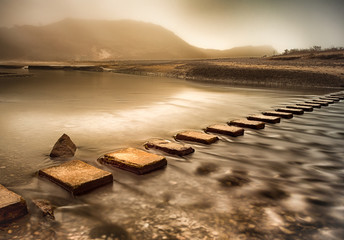Stepping stones across Three Cliffs Bay river, Gower peninsula, Swansea.