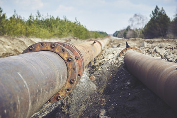 Steal big pipeline on a ground. Old pipes joint.