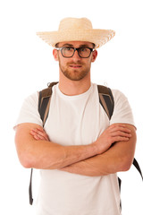 Traveler with straw hat, white shirt and backpack standing isola