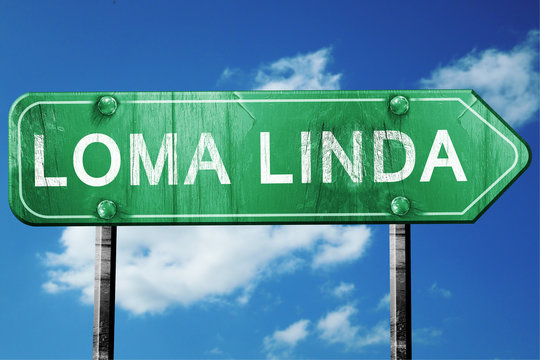 loma linda road sign , worn and damaged look