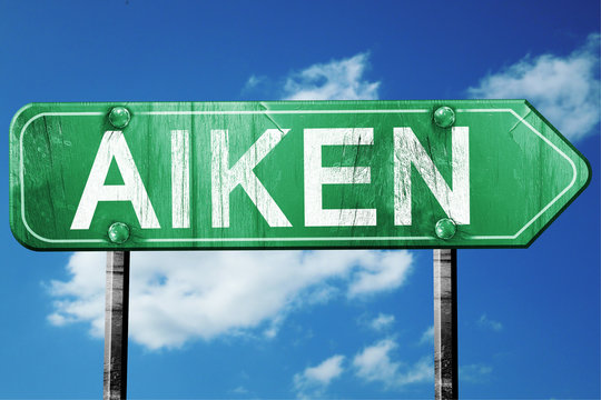 aiken road sign , worn and damaged look
