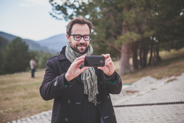 Man taking a photo with a smart phone.