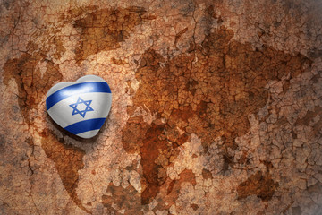 heart with national flag of israel on a vintage world map crack paper background.