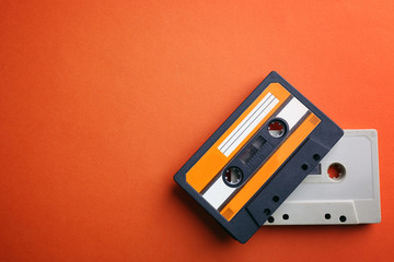 Old audio cassettes on red background