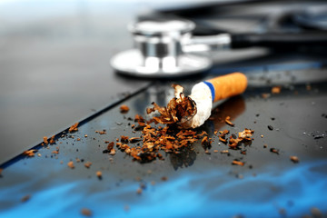 Cigarette and stethoscope on x-ray lung, close up