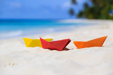 colorful paper boats at tropical beach