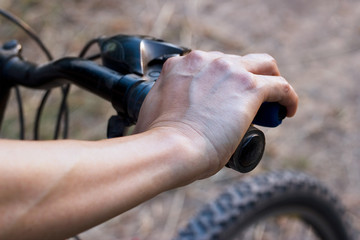 hands on handlebar bicycle on nature background