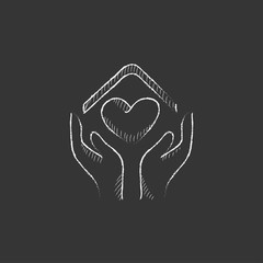 Hands holding house symbol with heart shape. Drawn in chalk icon.