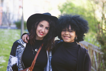 portrait of two young friends outdoors