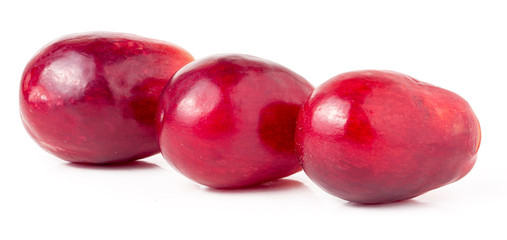 three red berries of grapes isolated on white background