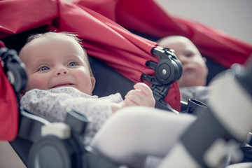 Smiling blonde couple baby seated on stroller