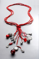 Bunched necklaces made of red glass beads