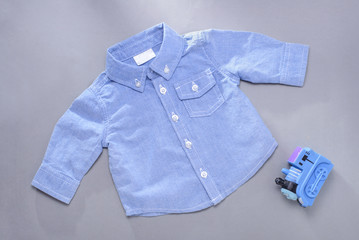 Single blue infant long sleeve shirt and toy