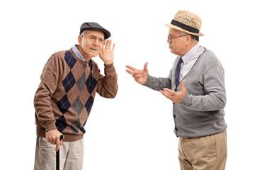Senior man struggling to hear a friend