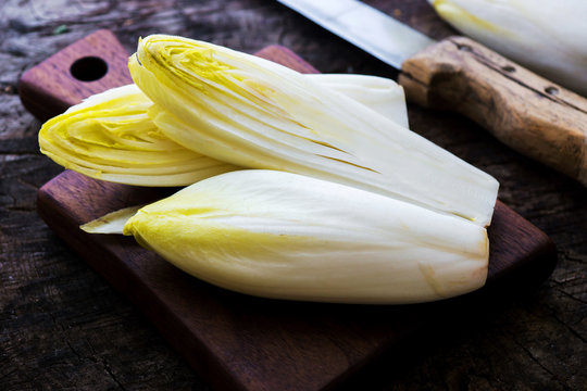 Fresh Chicory Salad  on  rustic wooden table.