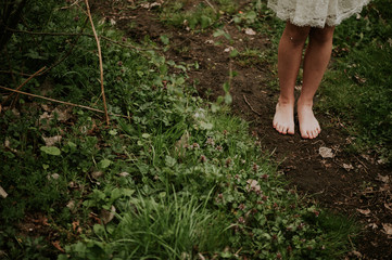 Close-up of a bare legs of a girl in the woods