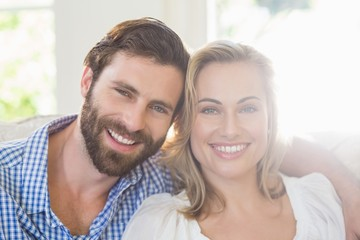 Portrait of smiling couple with arm around
