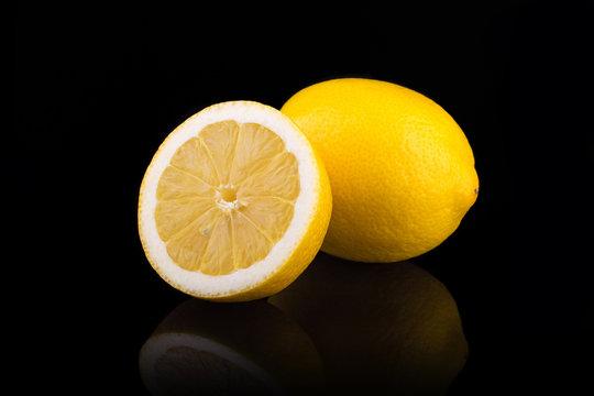 Ripe lemons. Isolated on black background