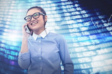 Composite image of smiling asian businesswoman on phone call