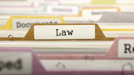 Law Concept on Folder Register in Multicolor Card Index. Closeup View. Selective Focus. 3D Render.