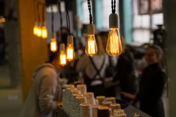 Selective focus view on light bulbs in cafe