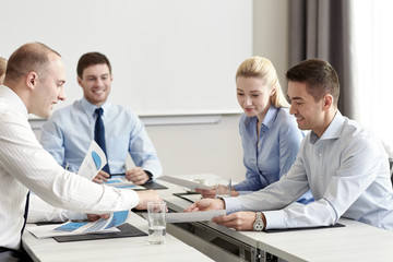 business people with papers meeting in office