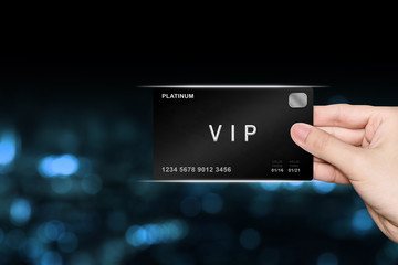 hand picking VIP or very important person platinum card