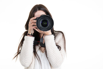 Pretty woman is a professional photographer with slr camera