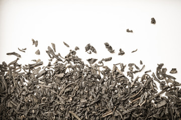 Dry black tea leaves as texture for background. Toned