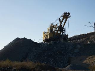 Quarry excavator working near railroad