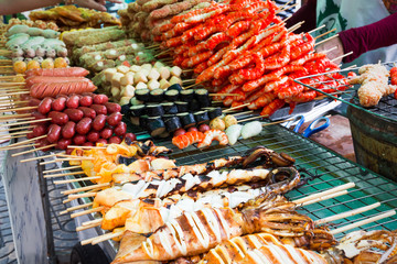 Meatballs  and seafood on sticks at a market in Bangkok, Thailan