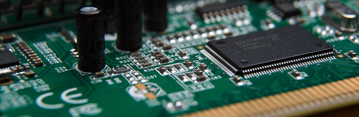 computer circuit Board close up isolated on wooden table