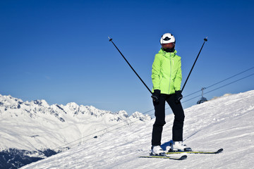 young woman is enjoying winter sports in Austrian Alps