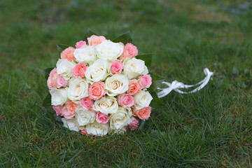 Roses wedding bouquet isolated on green grass
