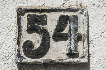 Old retro weathered cast iron plate with number 54