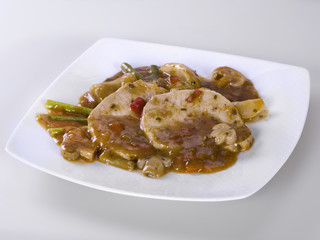 Meat sauce with beans, peppers and asparagus on white background