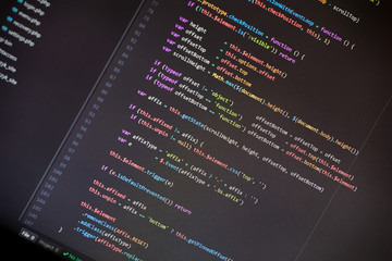 Colorful programming php and html code on a monitor.