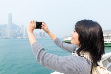 Woman taking photo in Hong Kong
