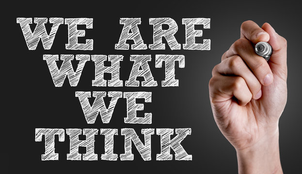 Hand writing the text: We Are What We Think