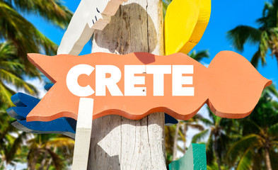 Crete signpost with palm trees
